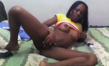 highly-sexed black floozie plays with her sex toys