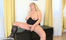 Fat old sexy mature woman plays with long glass dildo